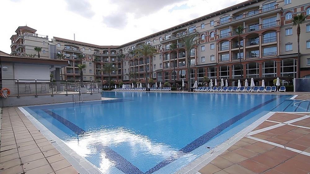 Ohtels islantilla suites hotel en islantilla viajes el for Piscina el corte ingles